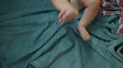 Feet of a six months old baby wearing diapers Stock Footage