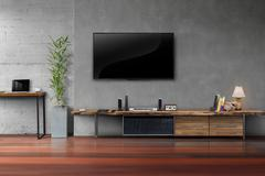 Living room led tv on concrete wall with wooden table media furniture Stock Photos
