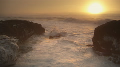 Waves and sea foam at sunset, Cape Perpetua State Park, Oregon Stock Footage