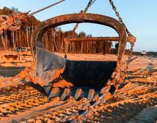 Horizontal vivid sand mining industrial scoop background backdro - stock photo