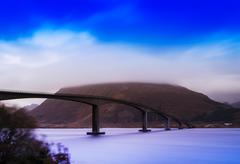 Horizontal vivid vibrant Norway bridge river flow wind landscape Kuvituskuvat