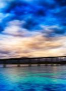 Vertical vivid vibrant aqua blue yellow Norway bridge landscape - stock photo