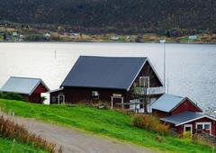 Horizontal vivid Norway house on the bank of the river landscape Stock Photos
