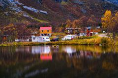 Horzontal vivid autumn Norway camping reflection background back Stock Photos