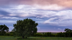 Time lapse - Storm clouds over vibrant sunset on the Montana prairie Stock Footage