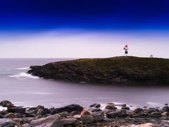 Horizontal vivid Norway lighthouse ocean bay landscape backgroun Stock Photos