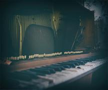 Inside old vintage opened piano bordered Stock Photos