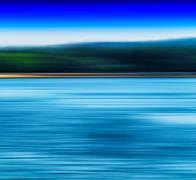 Horizontal vivid blur ocean horizon land landscape background ba Stock Photos