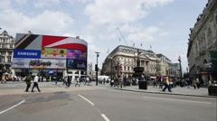 Timelapse of people crossing the road at Piccadilly Circus station to work Stock Footage
