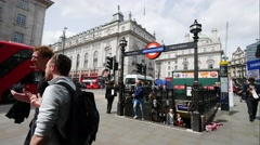 Timelapse of people using the under ground tube Piccadilly Circus station Stock Footage