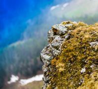Horizontal vivid high altitude mountain rock  bokeh background b Stock Photos