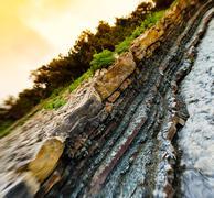 Horizontal viviid geological rock cut bokeh background backdrop Stock Photos