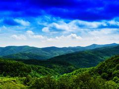 Horizontal vivid fresh hills landscape with cloudscape backgroun Stock Photos