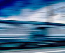Horizontal vivid blue train motion blur abstraction background b Stock Photos