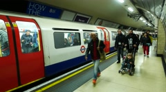 People using the under ground tube Tottenham Court Road station Stock Footage