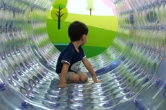 A little boy enjoys playing in a children playground - stock footage
