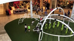 Top shot of kids on playground in Lougheed Town Centre mall Stock Footage