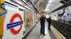 People using the under ground tube Tottenham Court Road statio Stock Footage