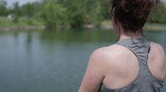 Over the shoulder shot of Middle aged woman practicing yoga Stock Footage