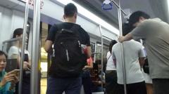 Shenzhen, China: subway passenger compartment Stock Footage