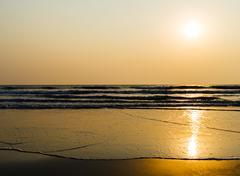Horizontal vivid golden tidal waves with sun reflection backgrou Stock Photos