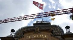 Tivoli main entry with flag and crane in Copenhagen Stock Footage