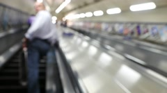Blur footage of busy commuters on elevators of an underground station in London. Stock Footage