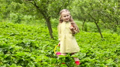 Little girl eating a strawberry Stock Footage