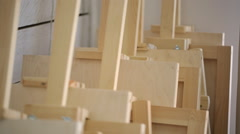 Many wooden easels stands near wall in art studio Stock Footage