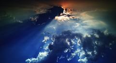 Horizontal dramatic sunset beams in cloudscape background Stock Photos