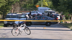 Toronto police officers at gun crime and shooting murder scene - stock footage