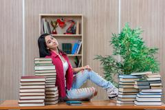Young female student preparing for college school exams - stock photo
