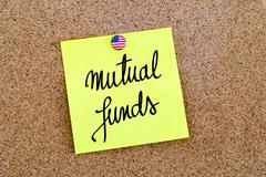 Written text Mutual Funds over yellow paper note - stock photo