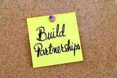 Written text Build Partnerships over paper note - stock photo