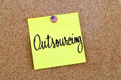 Written text Outsourcing over yellow paper note - stock photo