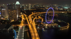 Aerial Night Time-lapse of Singapore Marina Bay Overlooking The Singapore Flyer - stock footage