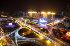 Busy traffic on road junction in downtown of hangzhou at night Stock Photos