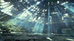 Movement deserted in a huge hall with sunlight penetrated with smoke Stock Footage
