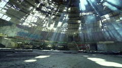 Movement abandoned in a huge hall with sunlight penetrated with smoke Stock Footage
