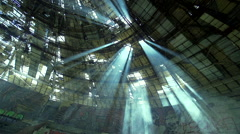 Sunrays penetrate the roof of an abandoned building Stock Footage