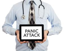 Doctor holding tablet - Panic attack - stock photo