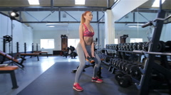 Woman does squats at the gym Stock Footage