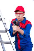 Young repairman with drill perforator isolated on white Stock Photos