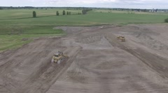 4k aerial two bull dozers pushing dirt Stock Footage