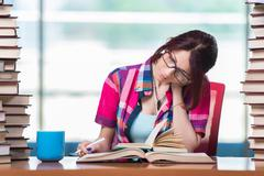 Young female student preparing for exams Stock Photos