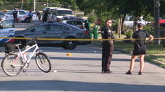 Toronto police officers at gun crime and shooting murder scene Stock Footage