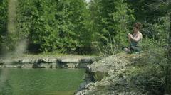 Middle aged woman doing yoga - stock footage