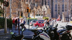Barcelona, Spain : Tourists and car traffic near the famous Stock Footage
