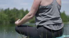 Scene of serenity - mom doing yoga - stock footage