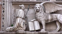 Venice, St Marks Cathedral sculpture of the Doge and winged lion of Venice. Stock Footage